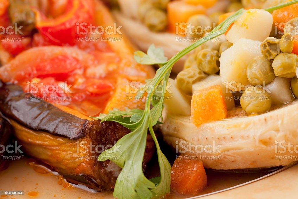 Artichoke and stuffed eggplant stock photo