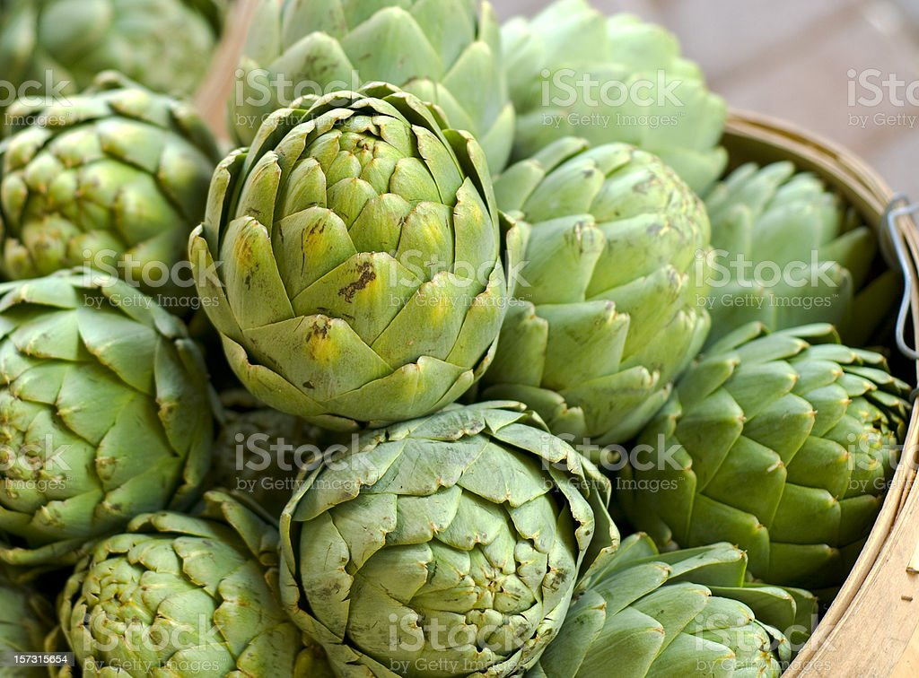 Artichoke in Baskets, Fresh Spring Vegetables at Farmer's Market stock photo