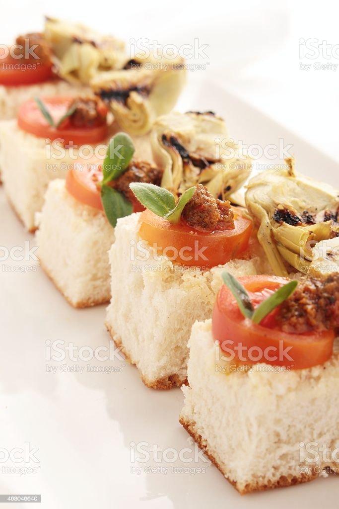 artichoke tomato pesto canapes stock photo