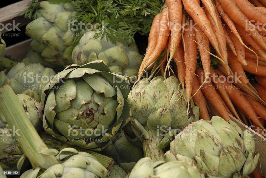 Artichokes and Carrots royalty-free stock photo