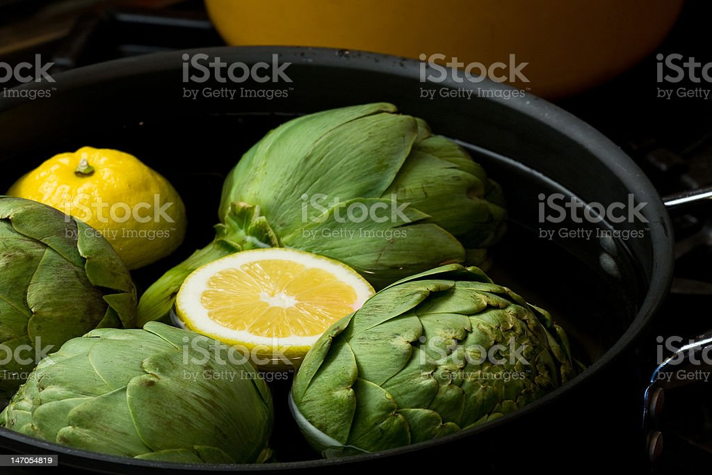 artichokes and lemons in pot royalty-free stock photo