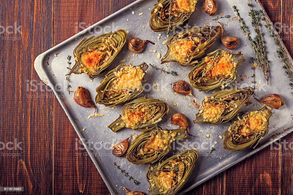 Artichokes baked with cheese, garlic and thyme. stock photo