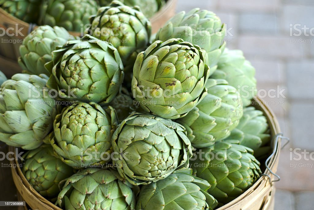 Artichokes Baskets, Fresh Spring Vegetables Food at Farmer's Market stock photo