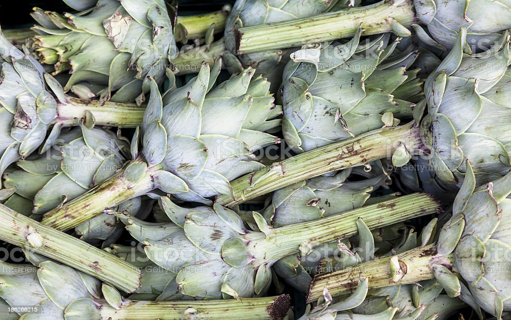 Artichokes in a bunch on some farmers market royalty-free stock photo