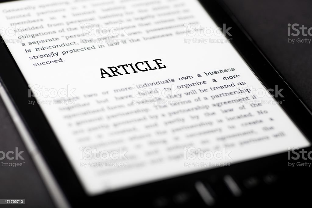 Article on tablet touchpad, ebook concept stock photo
