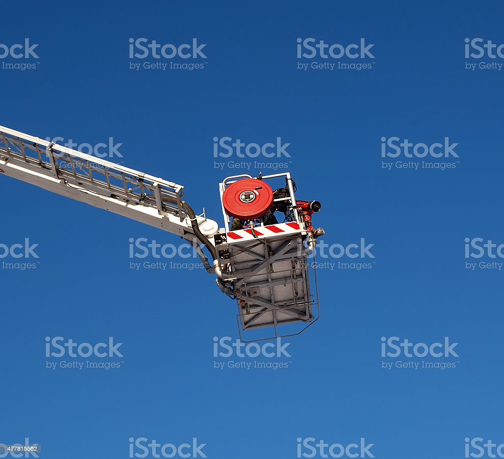Articulated aerial hydraulic platform against a blue sky stock photo