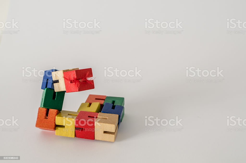 Articulated Colored Wooden Puzzle stock photo