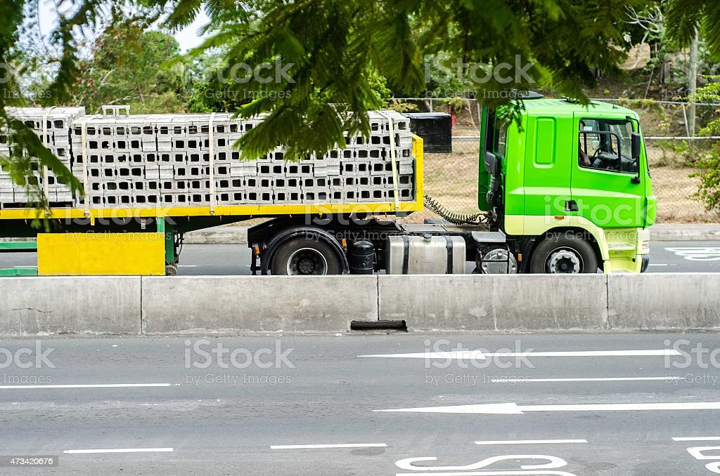 articulated lorry with heavy payload of concrete blocks stock photo