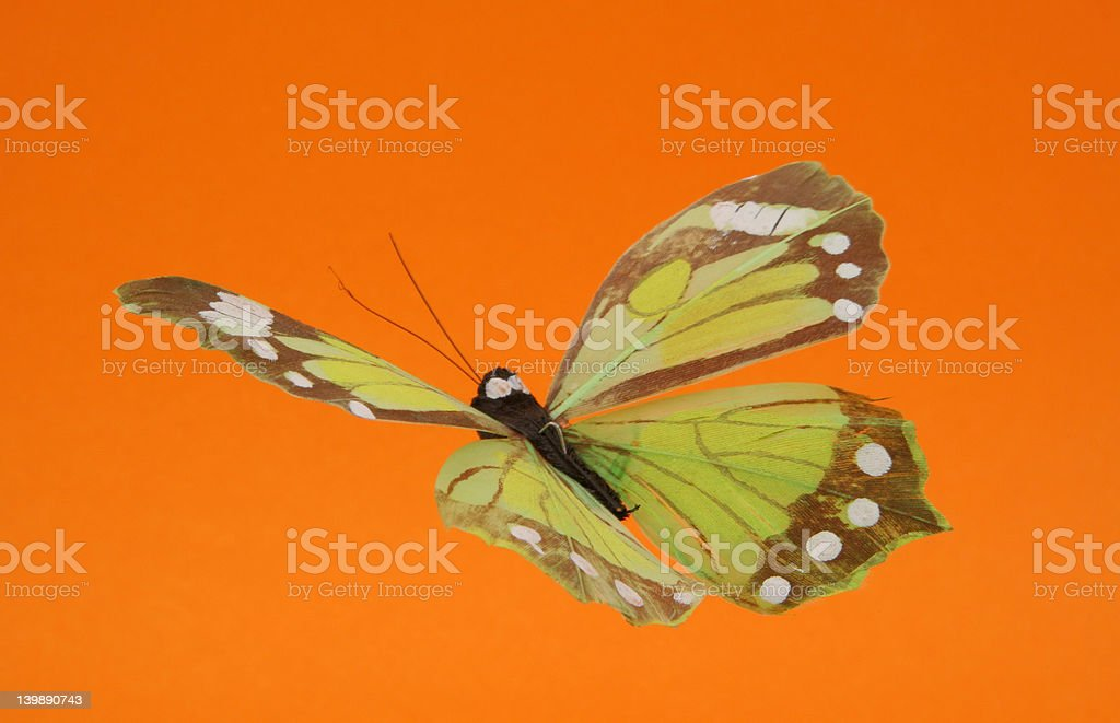 artificial butterfly in flight royalty-free stock photo