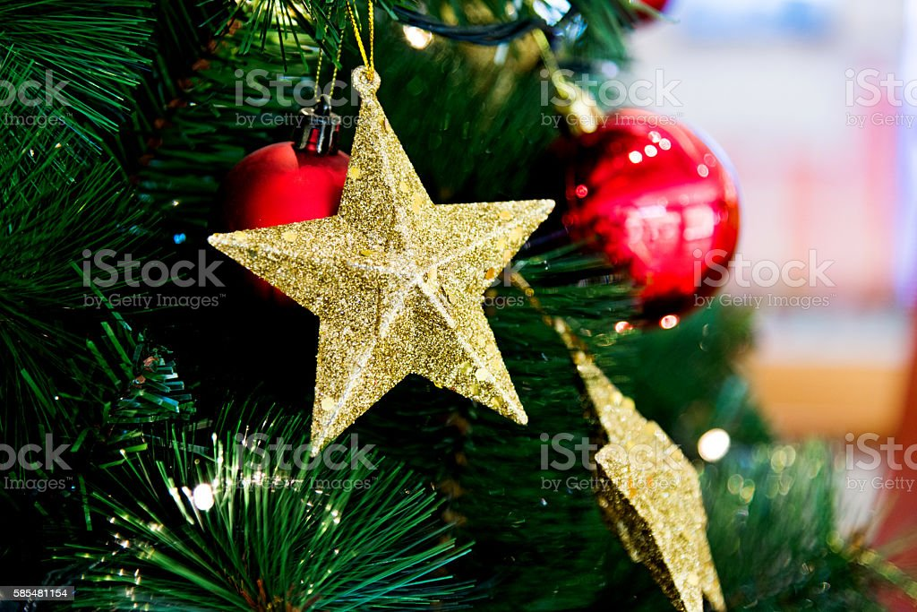 Artificial Christmas ornaments on tree stock photo