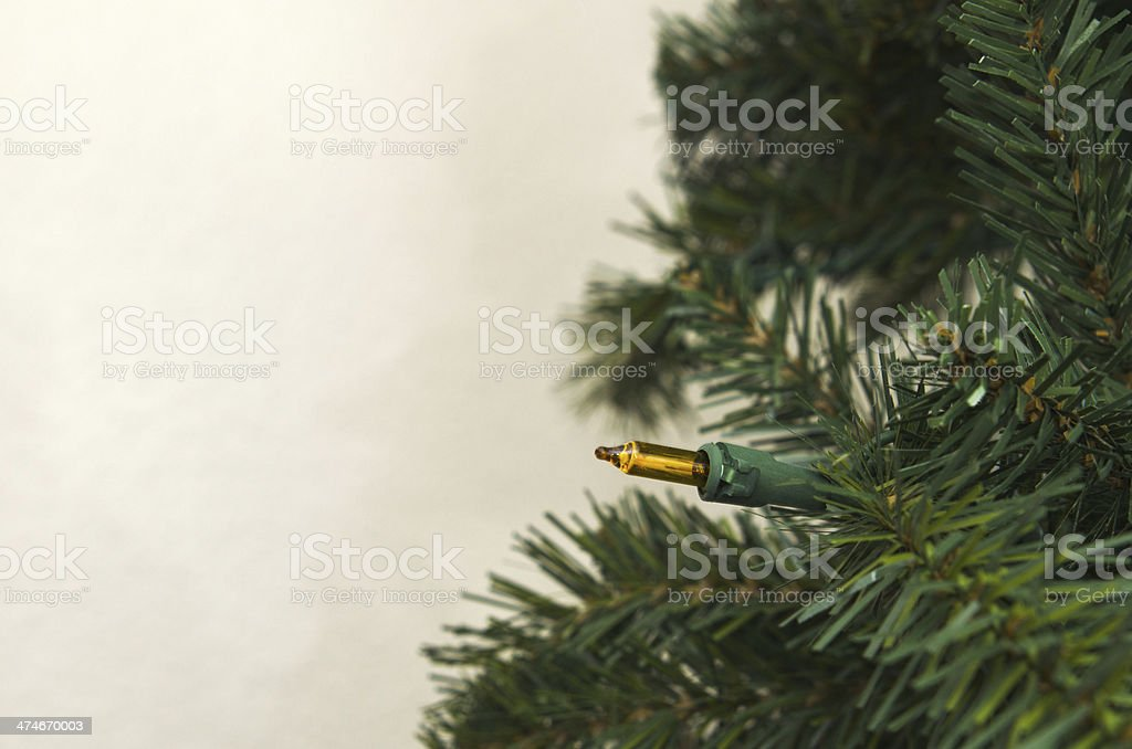 Artificial Christmas Tree Against Wall royalty-free stock photo