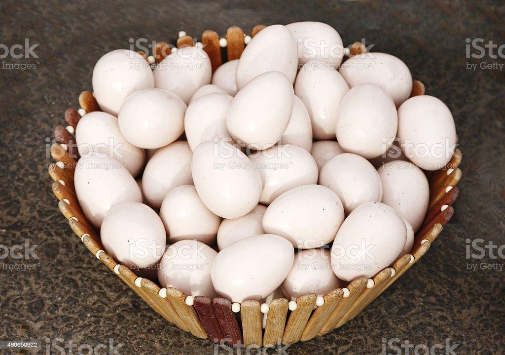 Artificial eggs kept in a basket stock photo