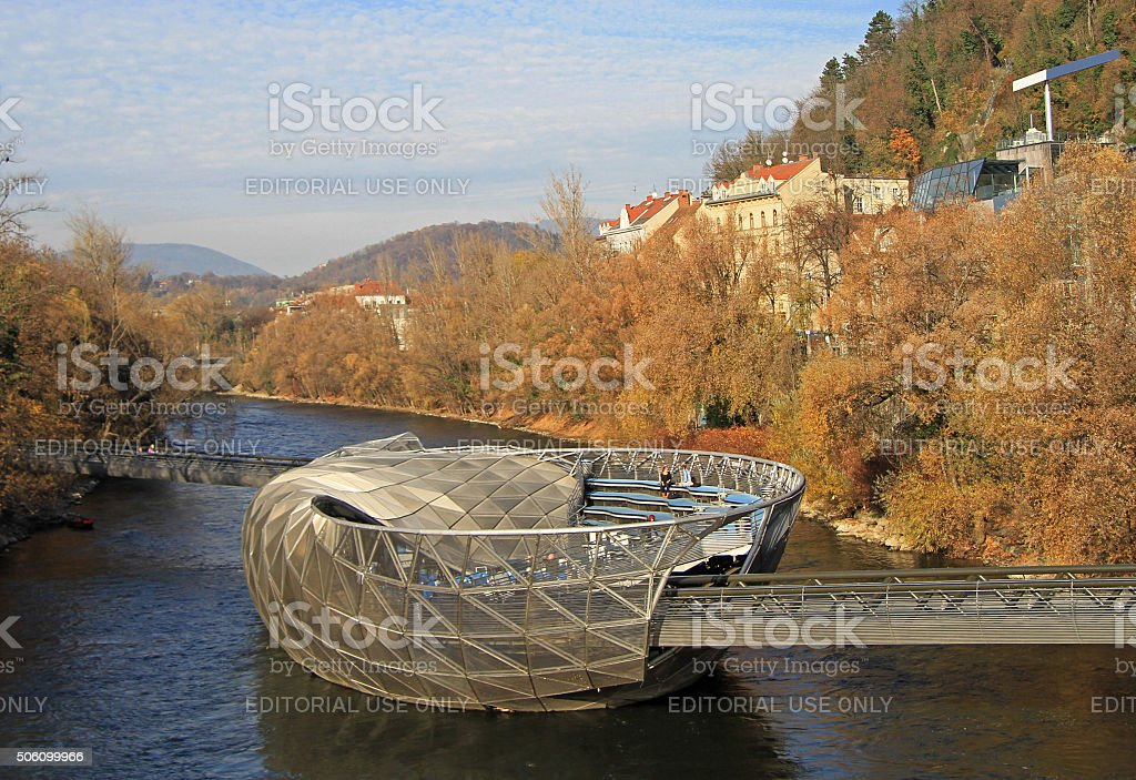 artificial floating platform in the middle of Mur river stock photo