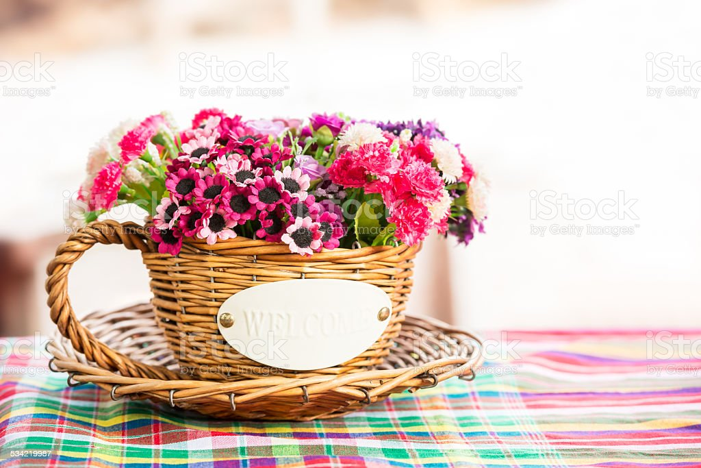 Artificial flower in rattan cup stock photo
