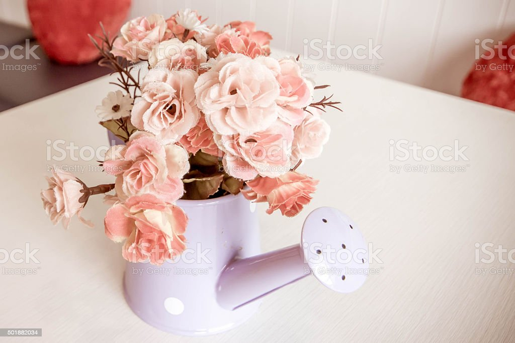 Artificial flower in vintage style coffee shop. stock photo