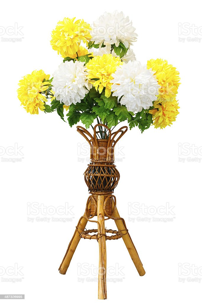 Artificial flowers and wicker wooden vase royalty-free stock photo