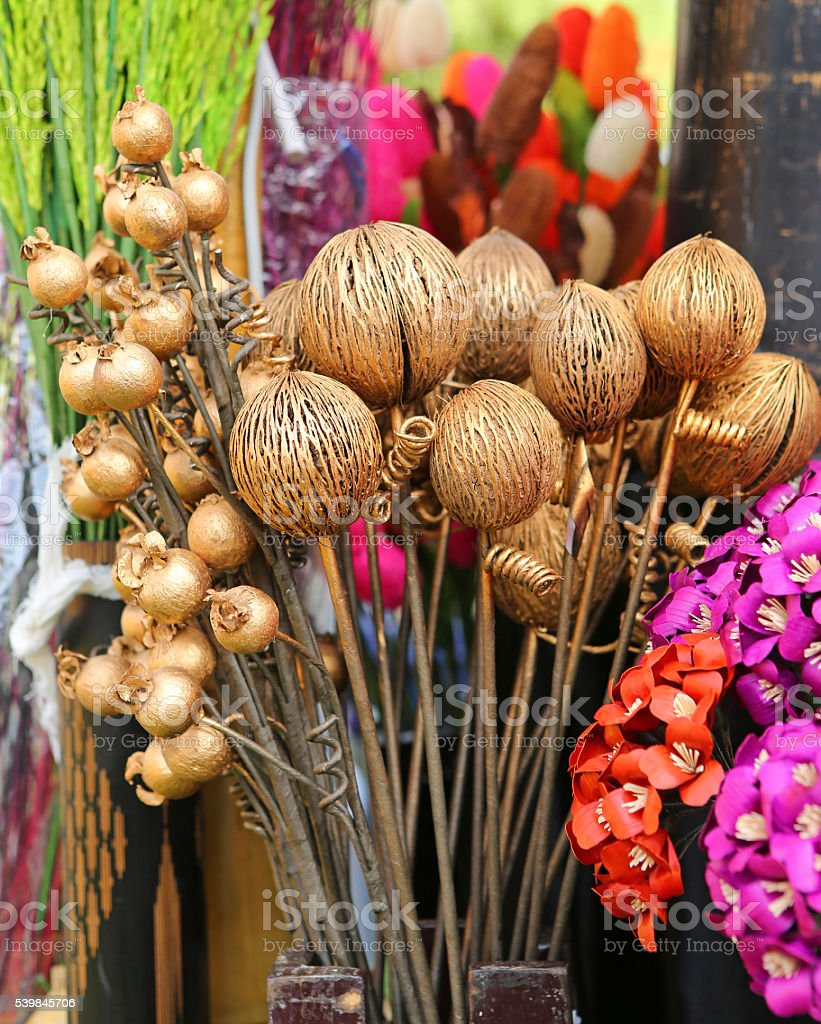 Artificial flowers made from coconut shell for home decor stock photo