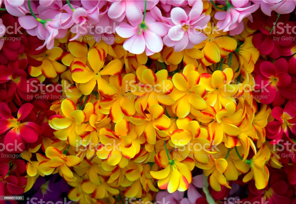 Artificial flowers on the market , plastic flower stock photo