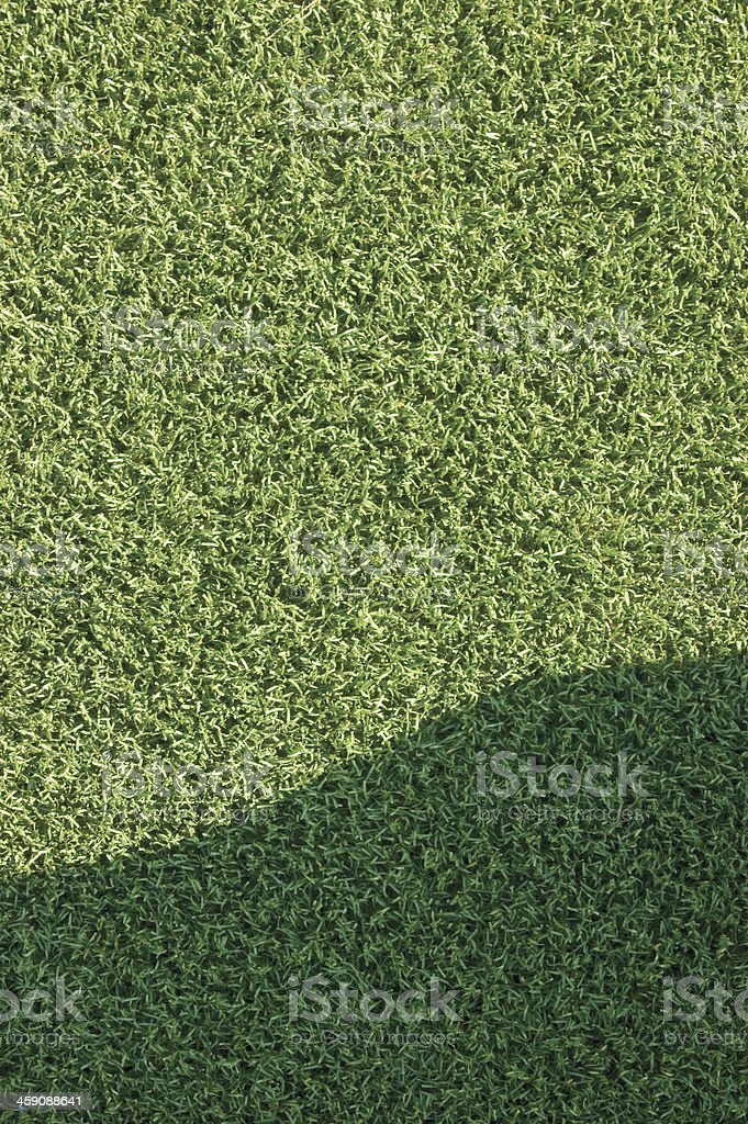 Artificial grass fake turf synthetic astroturf lawn field macro closeup stock photo