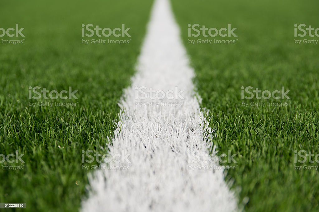 Artificial grass with white stripe. stock photo