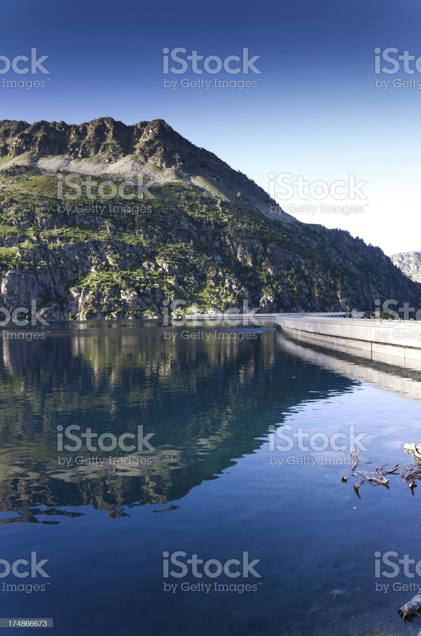 Artificial lake of the dam at sunset royalty-free stock photo