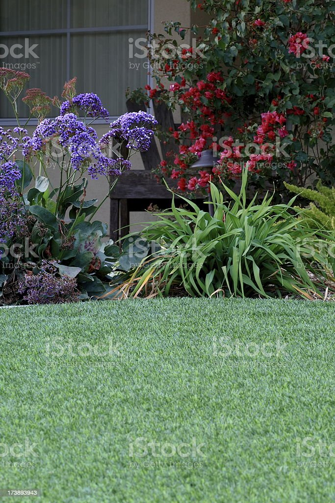 Artificial Lawn with Bench Closer stock photo