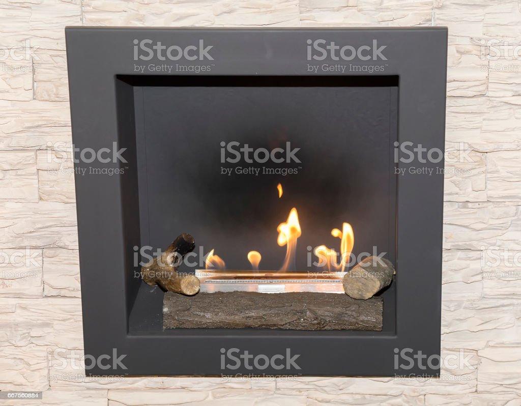Artificial natural gas fireplace stock photo