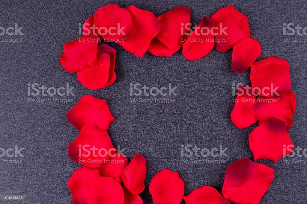 Artificial petals black background frame stock photo