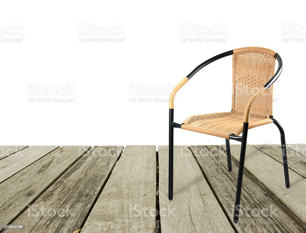 artificial rattan chair on wood stock photo