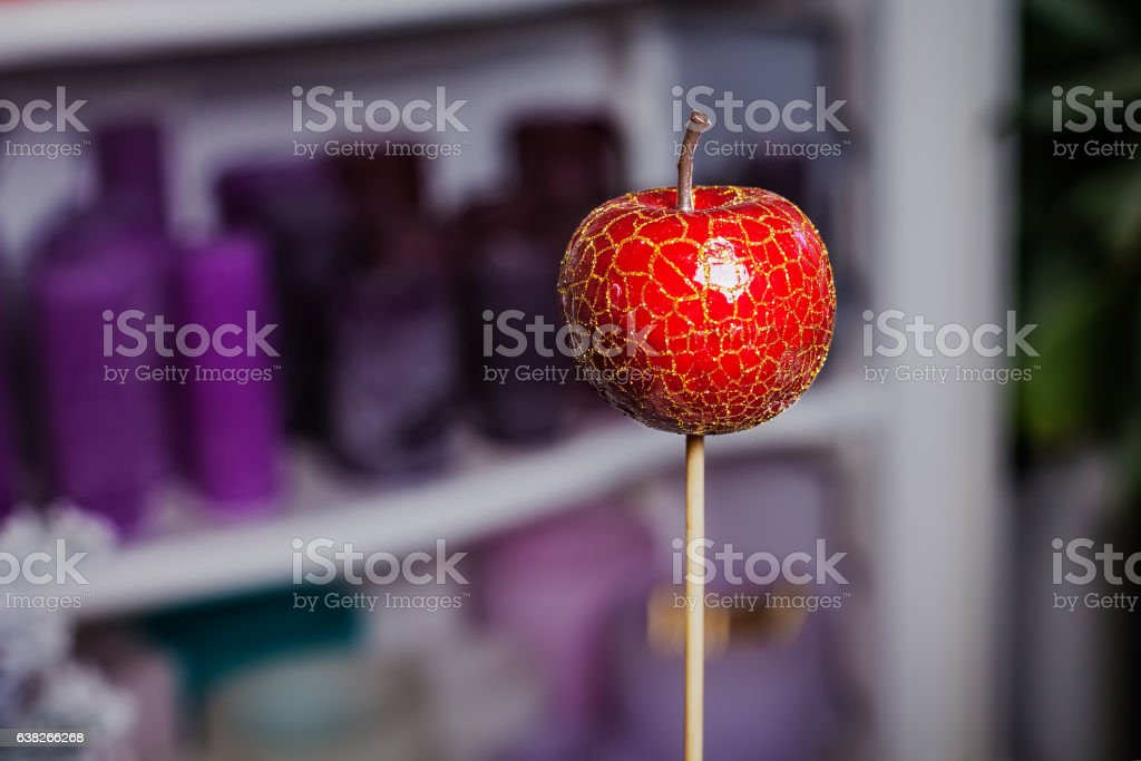 artificial red apple on a stick. apartment decor stock photo