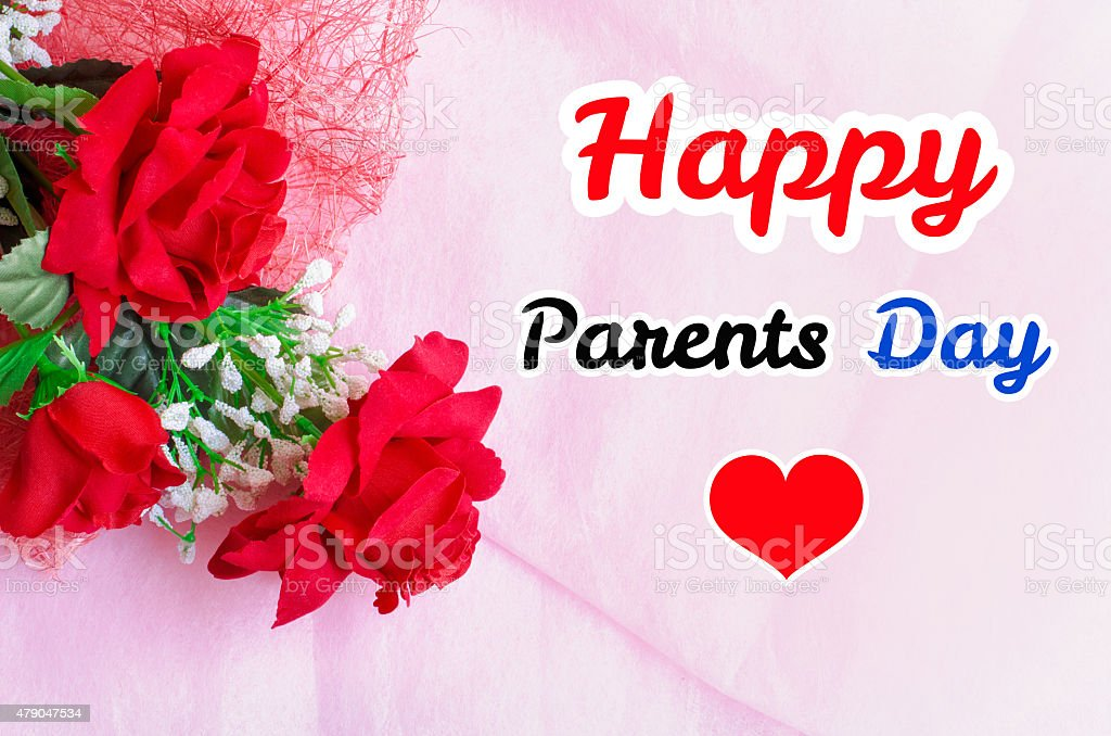 Artificial red rose bouquet with Happy parents day text stock photo