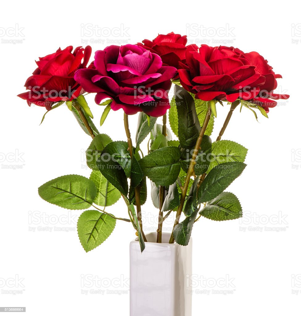 Artificial red roses in vase isolated. stock photo