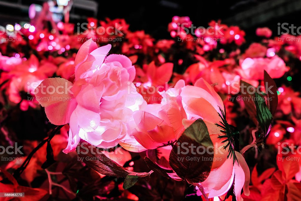 Artificial rose with LED light stock photo