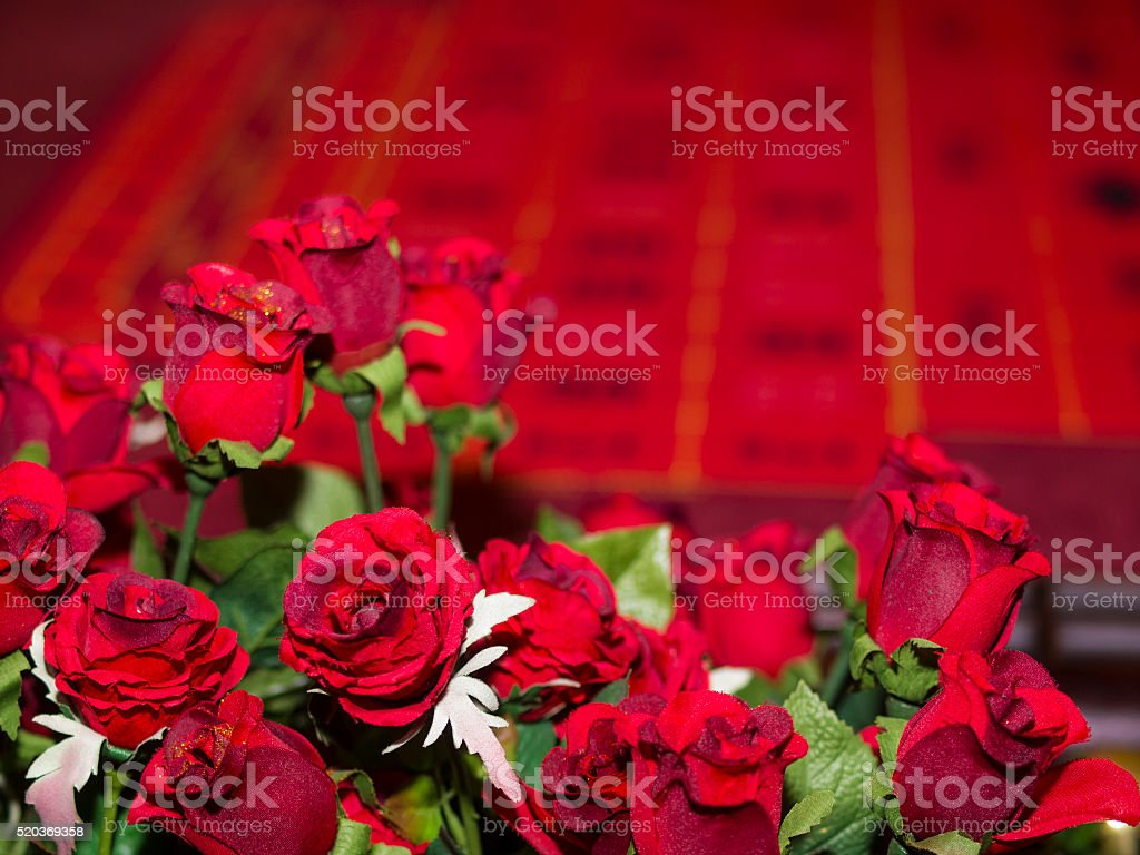 Artificial roses and gambling table stock photo