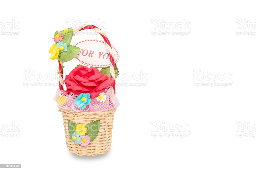 artificial roses in rattan basket on white background stock photo