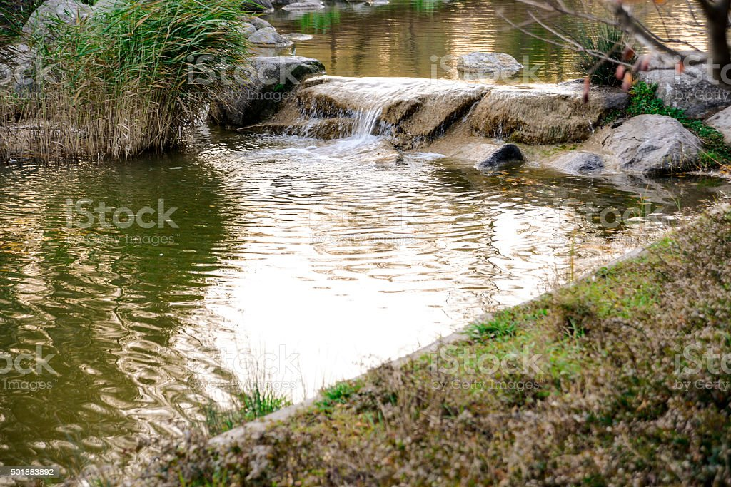 Artificial Waterfall And The Pond stock photo
