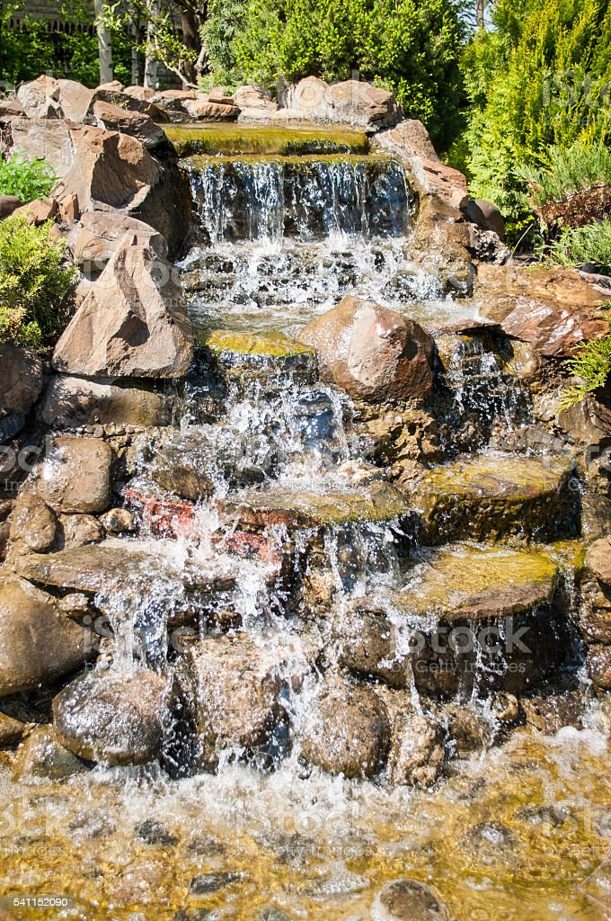 artificial waterfall element of landscape design stock photo