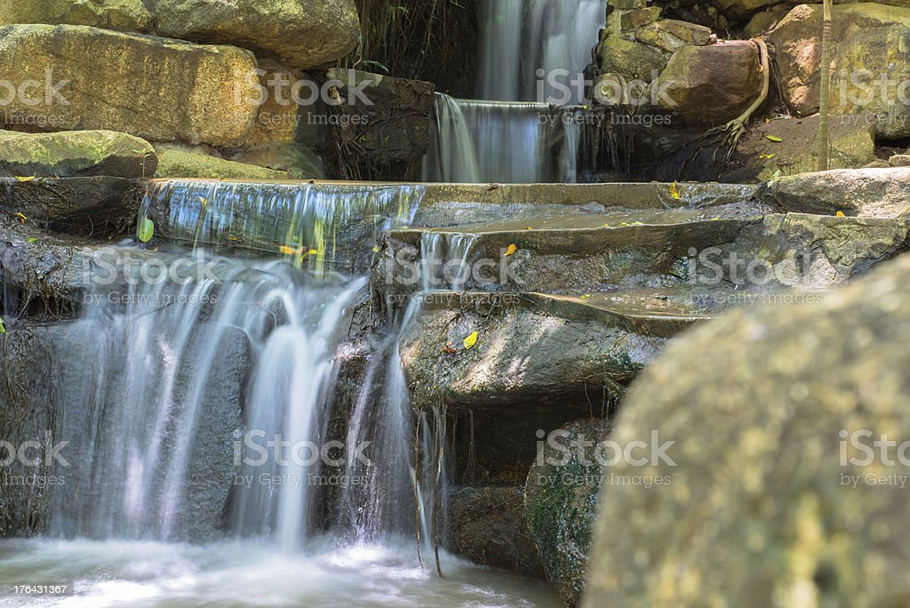 Artificial waterfall in botanic garden royalty-free stock photo