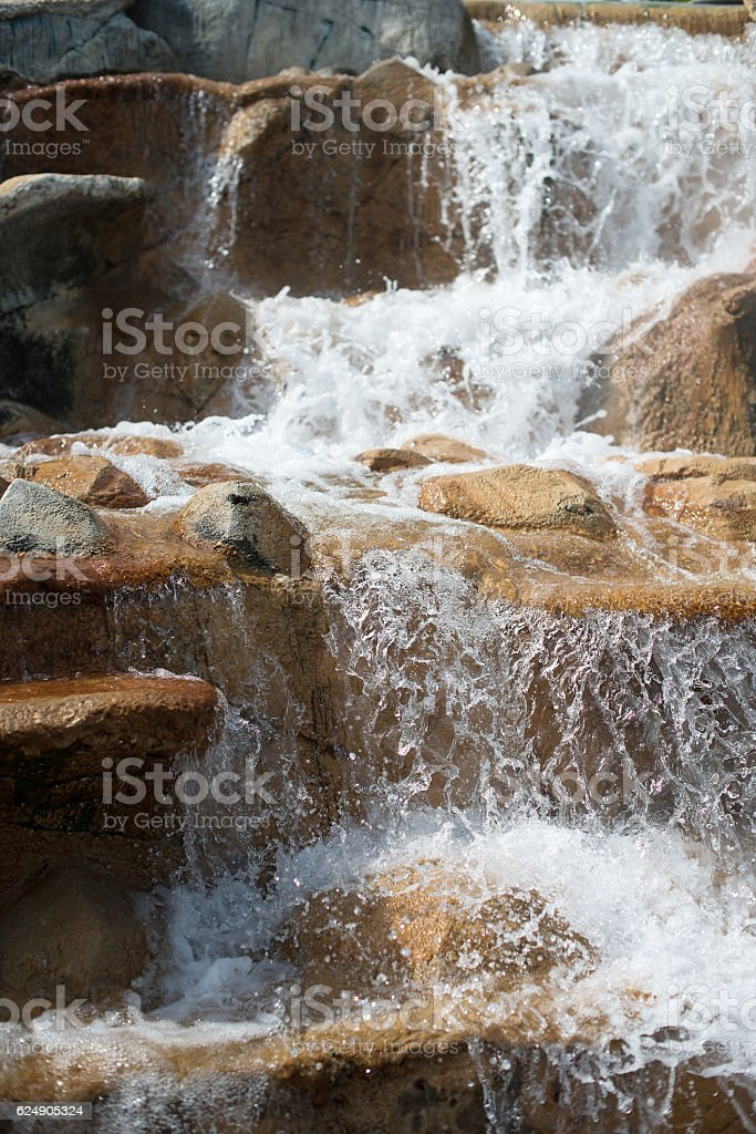 Artificial waterfall in the park. stock photo
