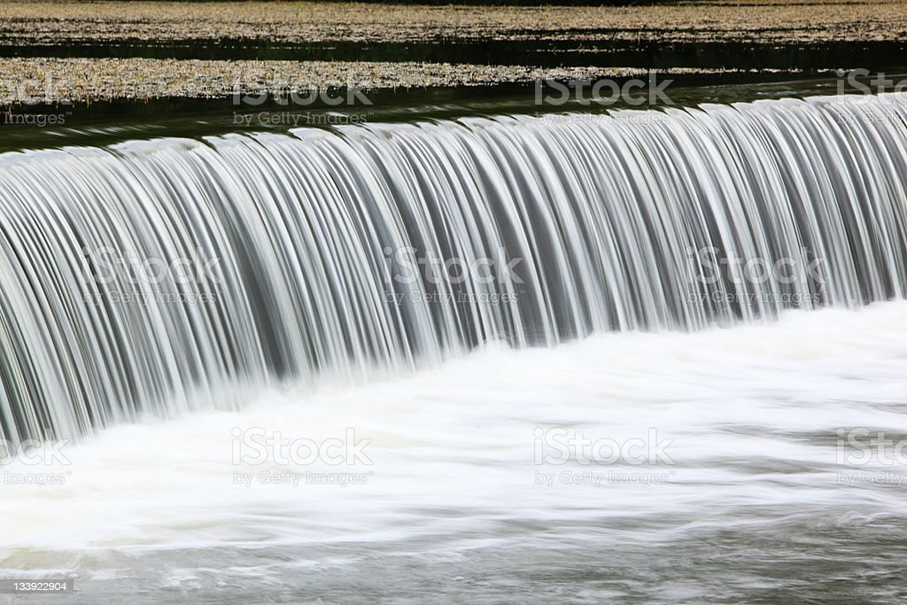 artificial waterfall on weir royalty-free stock photo