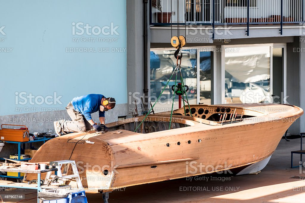 Artisan at work in the construction of boat stock photo