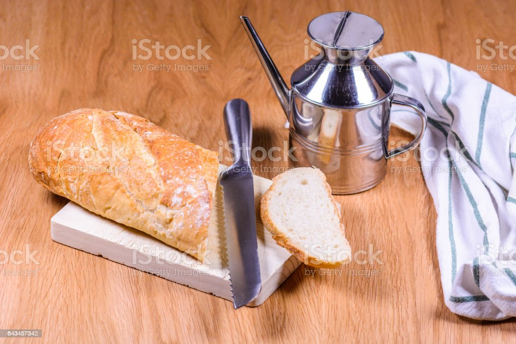 Artisan Bread on table wood knife with stainless steel oilcan stock photo