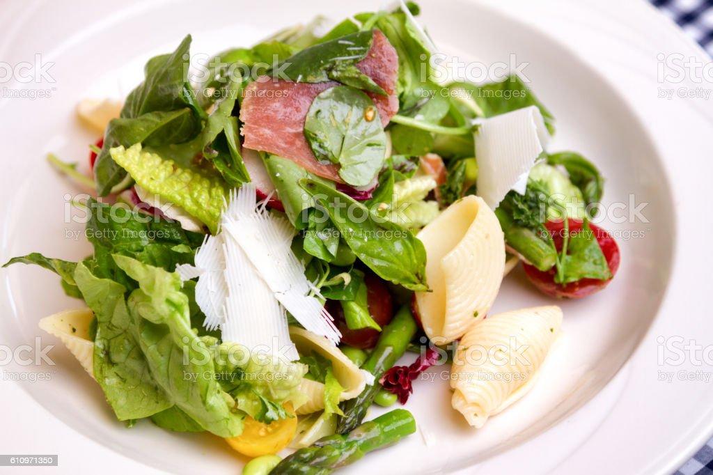 Artisan Caesar Salad with Salami and Pasta stock photo