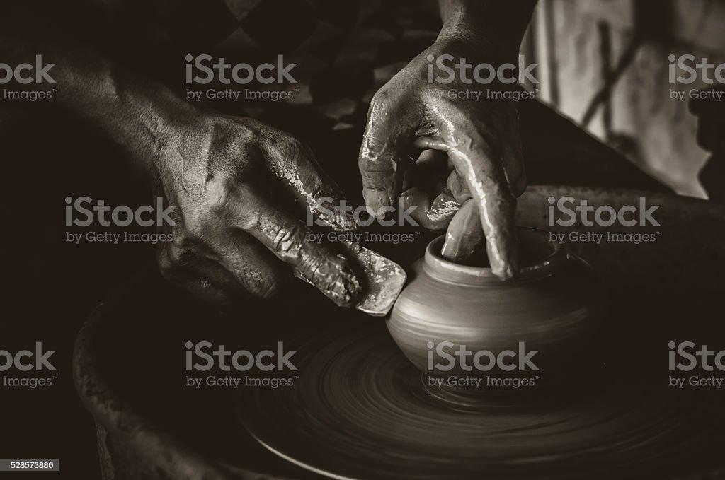 Artisan hands making clay pot stock photo