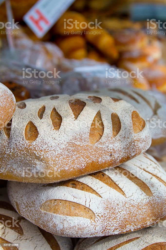 Artisan loaves of bread in a Farmers market stock photo