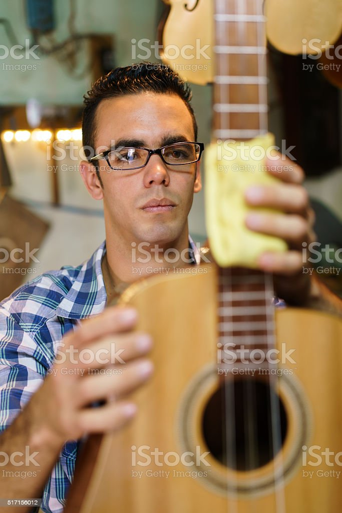 Artisan Lute Maker Cleaning Stringed Music Instrument In Shop stock photo