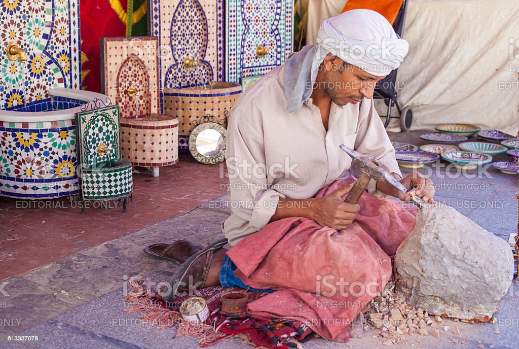Artisan makes pieces for mosaic craftwork stock photo