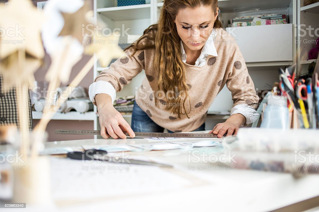 Artisan woman working with paper stock photo