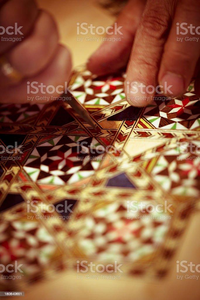 Artisan working in La Alhambra, Spain stock photo