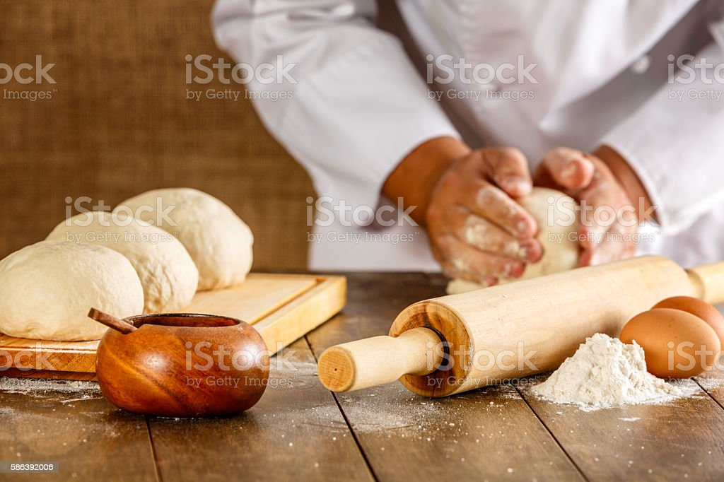 Artisanal bakery: Artisan Chef Hands kneading dough stock photo